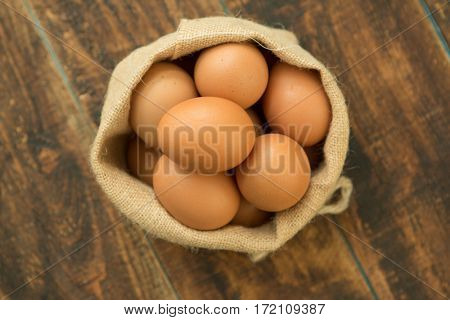 Many raw eggs in a wooden background