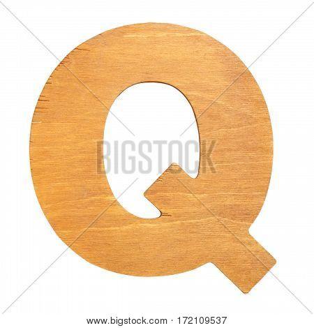 Vintage wooden letter Q on wooden background. One of full alphabet wooden set