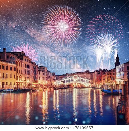 Rialto Bridge Ponte Di Rialto in Venice, Italy at night. Brightly Colorful Fireworks. Photo greeting card.
