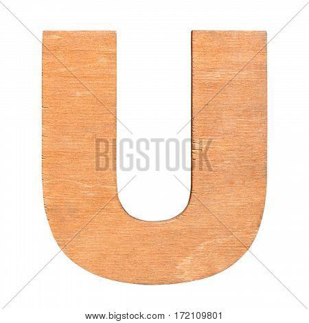 Old wooden letter U on wooden background. One of full alphabet wooden set