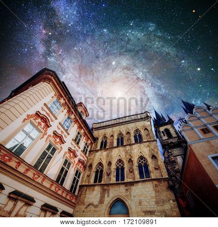 Fantastic starry sky and the milky way. Beautiful houses Czech Republic. Courtesy of NASA.