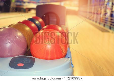 Bowling Balls on the background of the tracks in the bowling club. Play bowling and relax.