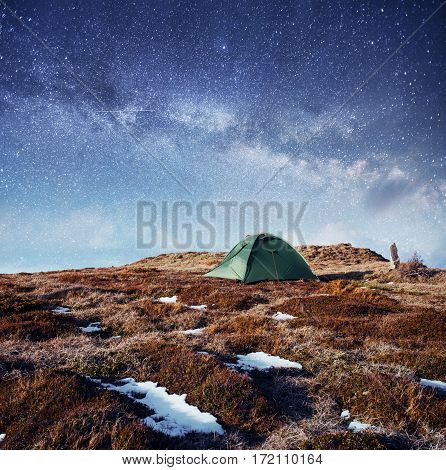 the starry sky above the tent in the mountains. Magic event in frosty day. In anticipation of the holiday. Dramatic scenes. Carpathians, Ukraine, Europe