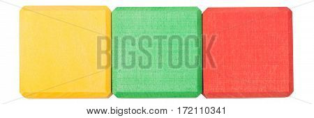 Red yellow green wooden blocks isolated on white background. Flat lay