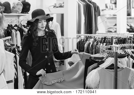 Young woman is shopping in clothing store