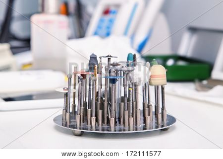 Close Up Photo Of Dental Tools – Drill Burrs And Denture Polishers In A Special Holde