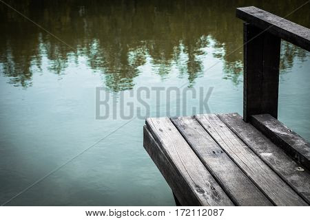 Wooden bench on a terrace above the river.