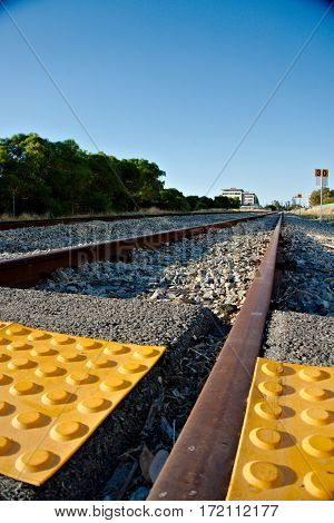 Low angle shot of a train track with tactile paving