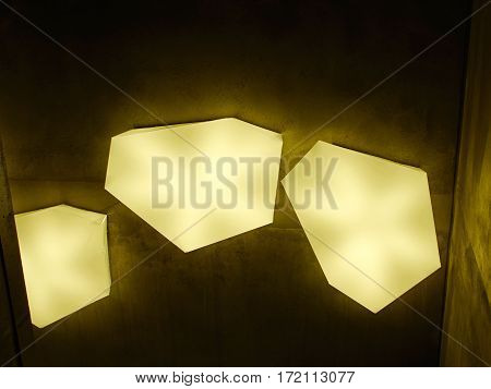Modern design lamp made out of white parts creating special light effect