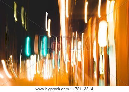 Light Blur Motion Effects In Downtown Street.