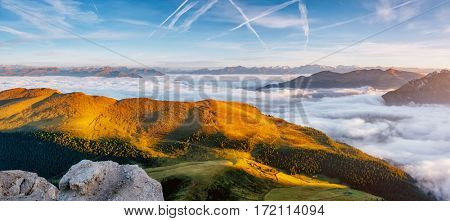 Aerial view of the alpine valley in sunlight. Great and gorgeous morning scene. Location place National Park Gardena, Seceda peak, Geisler or Odle Dolomiti group. Tyrol, Italy, Europe. Beauty world.