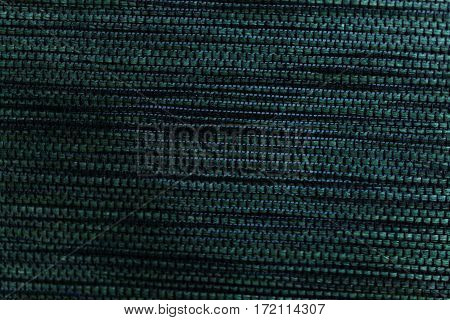 Green woven bast material as texture or background.