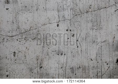 Gray color mortar crack wall texture background.