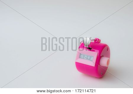 4 digi hand held tally counter in pink color show number 14 with white background valentine concept.