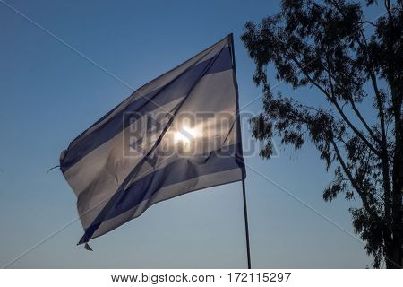 The israeli flag at early evening on sunset time