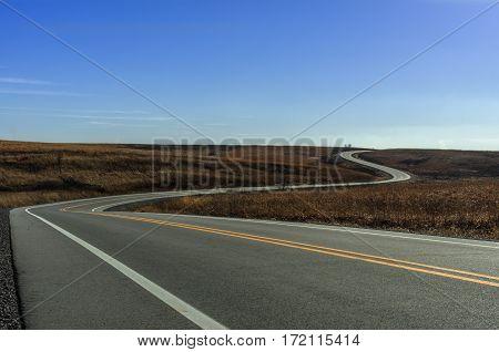 road winding through a prairie in Iowa
