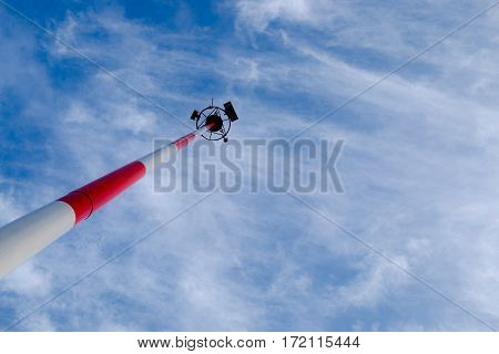 Transmission antenna radio tower pole on cloudy sky background