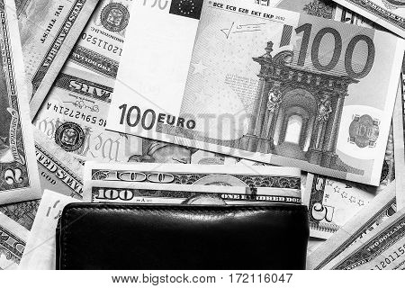 American Dollar And Euro Bills And Black Wallet.
