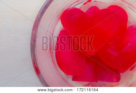Ice heart-shaped in a glass on day of love.