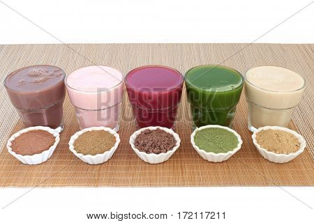 Health food drinks with corresponding  powders of chocolate whey, pomegranate fruit, acai berry, wheat grass and maca root. Also used by body builders.