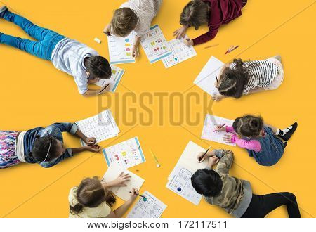 Group of students studying mathematics number