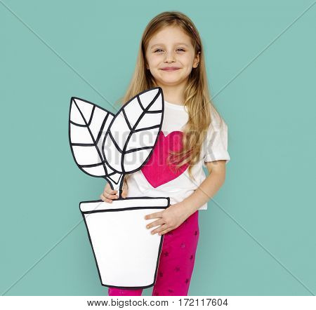 Little Girl Holding Papercraft Plant Smiling
