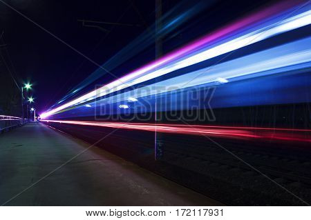light trace of train speed background in the city