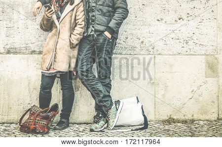 Multiracial couple on phase of mutual disinterest using phone - Modern relationship breakup concept on always connected people - City urban lifestyle and everyday life rapport - Retro contrast filter