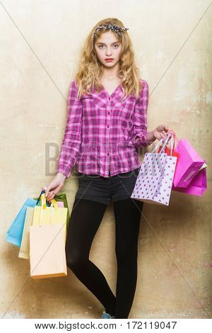 Pretty Girl With Colorful Shopping Bags In Hands