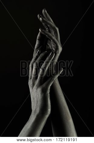 Dark-skinned Hands Over Black Background. Beautiful Hands.