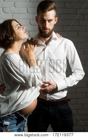 Bearded Man And Pretty Pregnant Woman With Round Belly