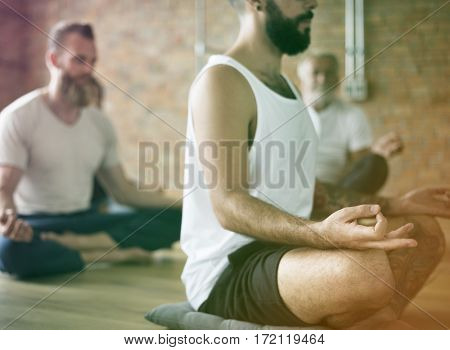 Men meditating gesture in a yoga class
