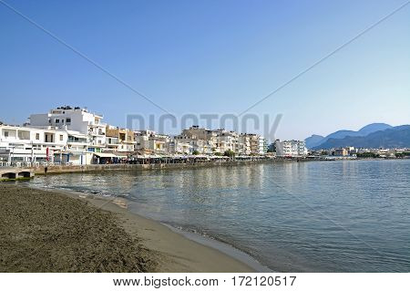 IERAPETRA, CRETE - SEPTEMBER 18, 2016 - View of the beach and waterfront buildings and restaurants Ierapetra Crete Greece Europe, September 18, 2016.