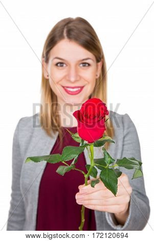 Picture of a beautiful young woman holding a red rose