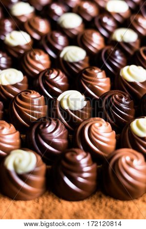 Assorted chocolate sweets with dark, milk and white chocolate, selective focus