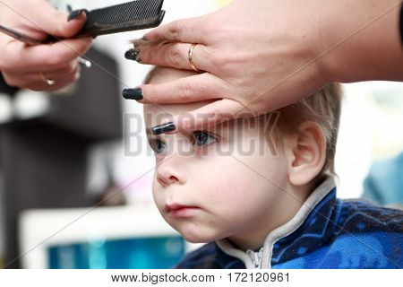 Thinking Child Having A Haircut First Time