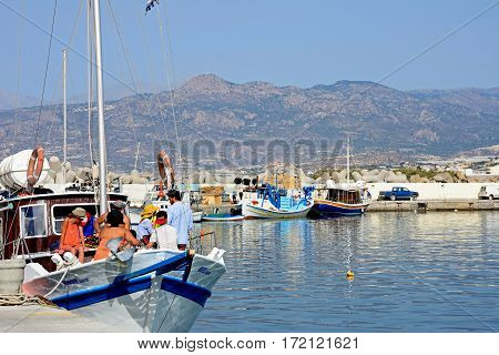 IERAPETRA, CRETE - SEPTEMBER 18, 2016 - Boats and yachts in the harbour with views towards the mountains Ierapetra Crete Greece Europe, September 18, 2016.