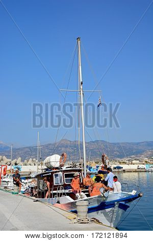 IERAPETRA, CRETE - SEPTEMBER 18, 2016 - Group of people on a yacht moored in the harbour with views towards the mountains Ierapetra Crete Greece Europe, September 18, 2016.