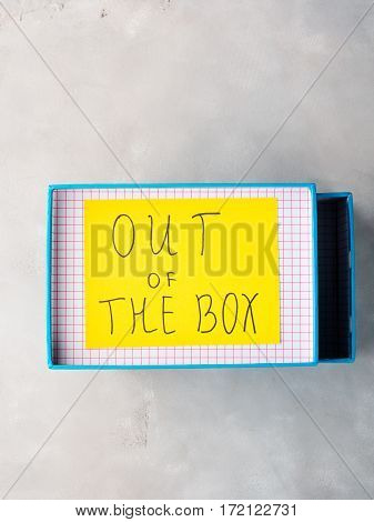 Think out of box creativity concept yellow card. Top view