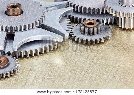 Various Gear Cogwheels For Industrial Equipment On Metal Background Macro