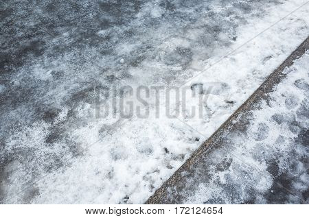 Winter Urban Road. Ice And Wet Snow