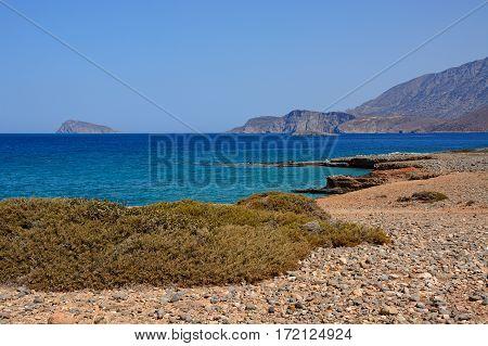 View of the sea and rugged coastline near Ammoudara Crete Greece Europe.