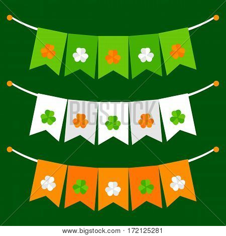 Colorful festive bunting set with clover on green background
