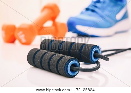 Expander and a dumbbells on white background