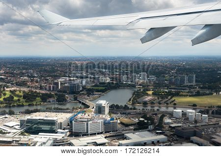 Sydney, Australia - Oct 29, 2016: View of Sydney Kingsford-Smith International Airport and the surrounding area soon after plane takes off from runway. The plane still ascending.