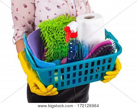 Close up picture of female housekeeper holding a basket of cleaning supplies