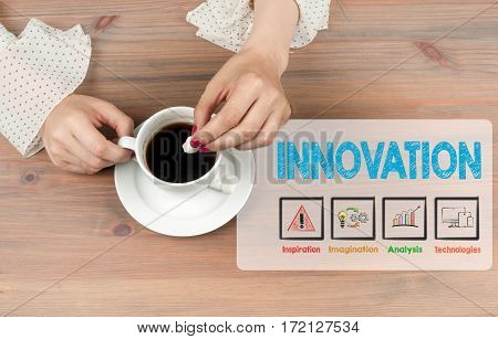 Innovation concept. Coffee cup top view on wooden table background.