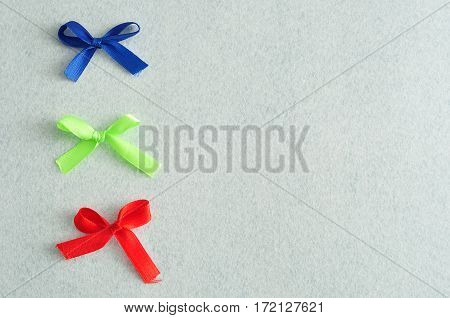 Three colorful bows isolated on a white background