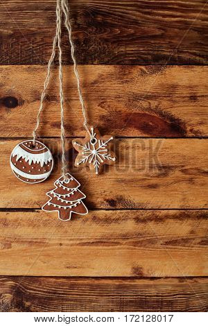 Gingerbread Cookies Hanging Over Old Wooden Background. Flat Lay, Top View, With Copy Space. X-mas B