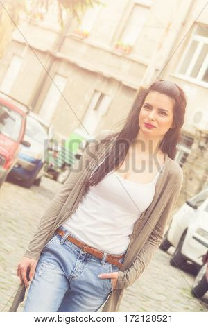 Cute and happy girl posing on the street.